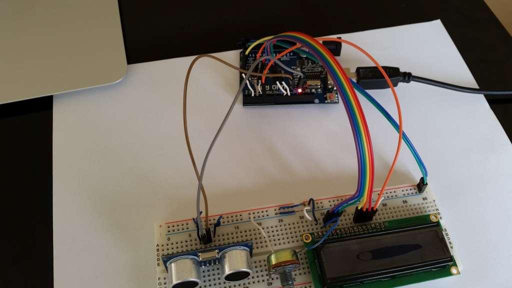 Arduino ultrasonic sensor reading displayed on blue LCD